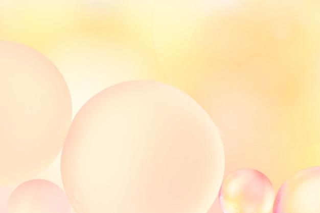 Weicher gelber abstrakter hintergrund mit luftblasen