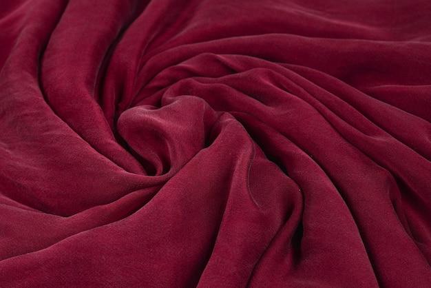 Weicher glatter burgunderfarbener seidenstoffhintergrund