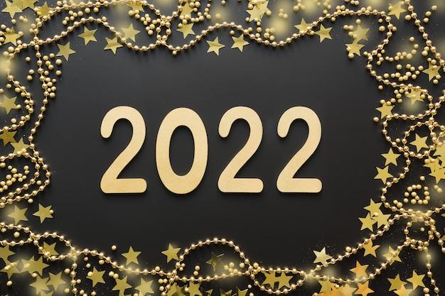 Weihnachten glänzender rand mit goldenem datum und perlen auf schwarzem hintergrund mit datum neujahr