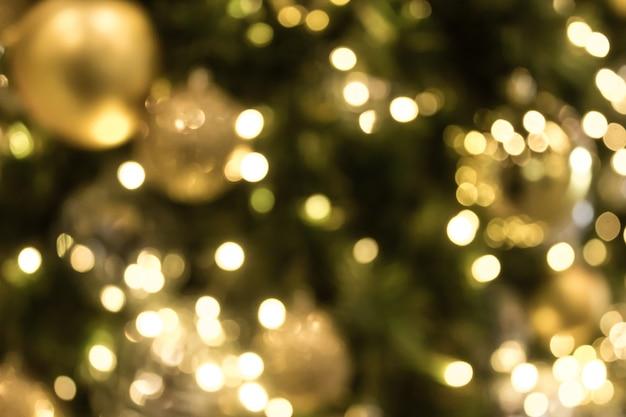 Weihnachten mit goldbokeh-lichthintergrund. weihnachten abstrakte unschärfe.