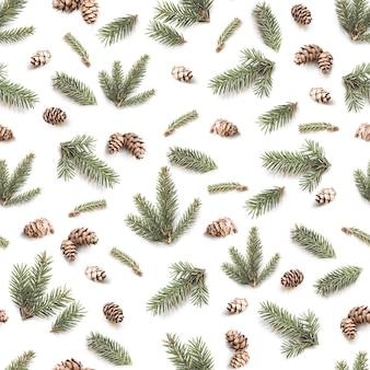 Weihnachten nahtlose muster von tannenzweigen und tannenzapfen. wintermuster auf weißem hintergrund.