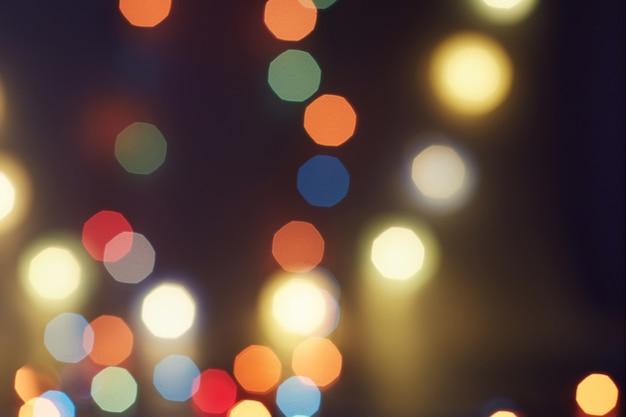 Weihnachtsbeleuchtung. jahreszeit-gruß-hintergrund. luxus-hintergrundbild des neuen jahres. unscharfer abstrakter feiertagshintergrund.