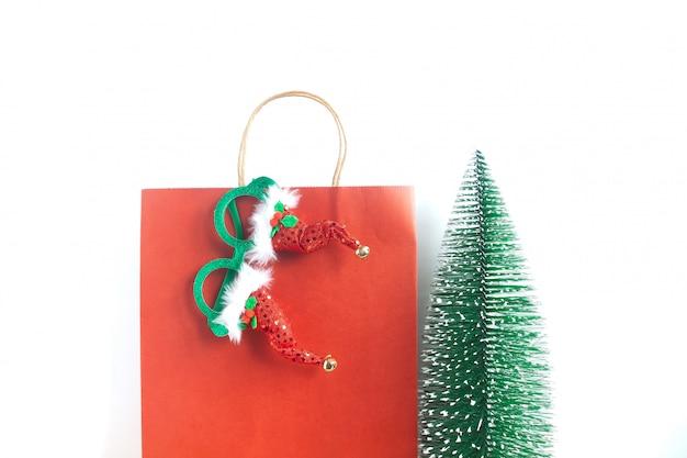 Weihnachtseinkaufstasche und partyzubehör