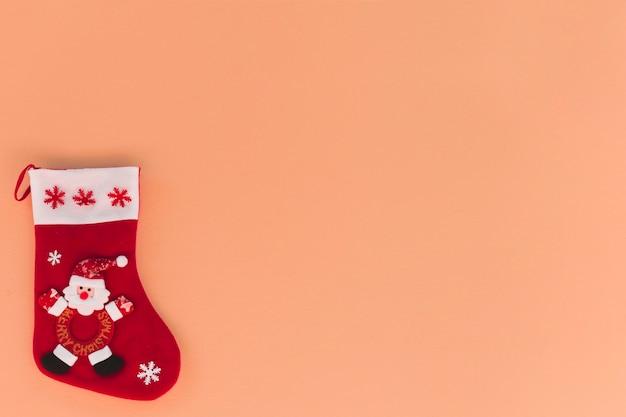 Weihnachtshintergrund mit weihnachtssocke