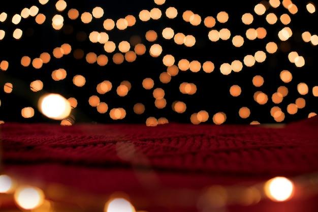 Weihnachtshintergrund und leuchtende bokeh-lichter mit exemplar