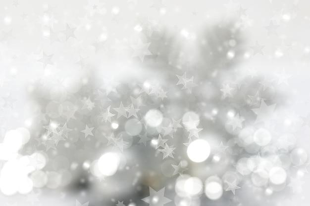 Weihnachtshintergrund von sternen und bokeh-lichtern
