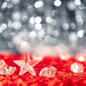 Weihnachtskristallstern auf eiswürfeln