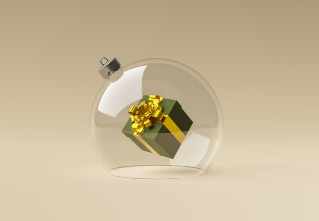 Weihnachtskugel aus kristall mit einer geschenkbox im inneren