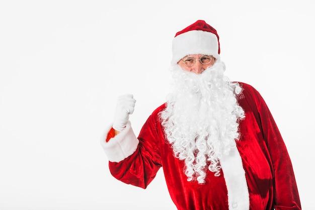 Weihnachtsmann, der faust zeigt
