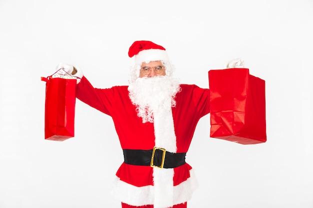 Weihnachtsmann, der weihnachtsbeutel anhebt