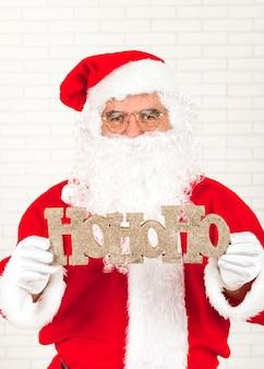 Weihnachtsmann gruß mit weihnachten