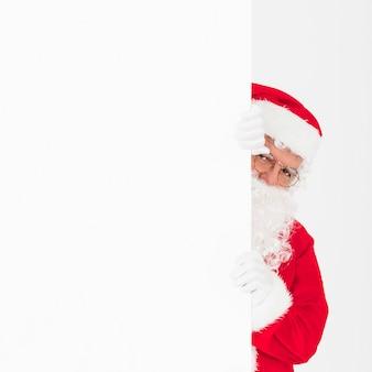 Weihnachtsmann hält leere fahne