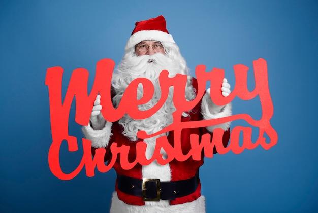 Weihnachtsmann mit weihnachtlichem banner