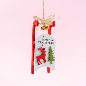 Weihnachtsmannschlitten auf rosa