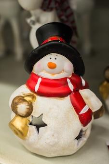 Weihnachtsschneemann auf holz
