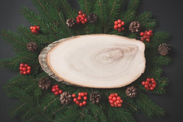 Weihnachtszusammensetzung des weihnachtsbaumasthintergrundes.