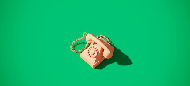 Weinlese-drehtelefon auf grünem hintergrund