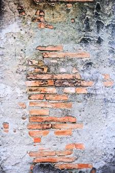Weinlese gealterte rotbraune farbe backte architektonische strukturierte ausführliche strukturelle innenarchitektur der lehmsteinziegelsteinblockwand für außenwand