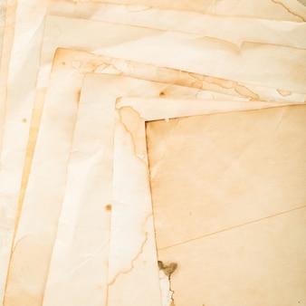 Weinlese geschriebenes papierhintergrund. nahansicht. hochwertiges foto