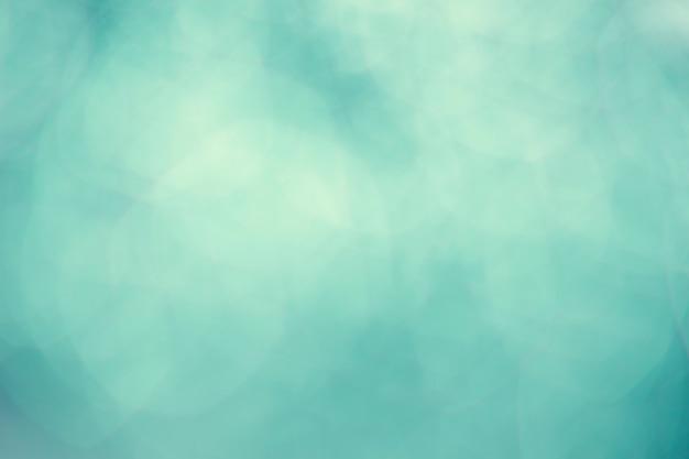 Weinleseaquaminngrüner abstrakter bokeh hintergrund