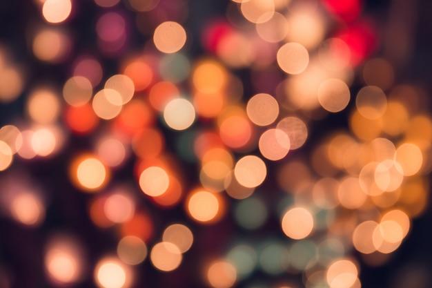 Weinleseton bokeh auf dem dunklen romantischen magischen nachthintergrund bunt.