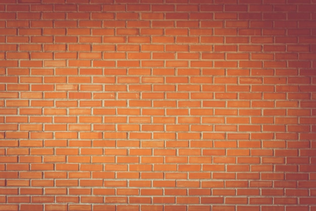 Weinleseton des orange lehmbacksteinmauerbeschaffenheit bacground, architekturwanddetail