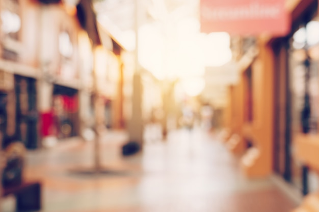 Weinleseton verwischte defocused tag von mengenleuten in gehendem straßenfestival und in einkaufszentrum.
