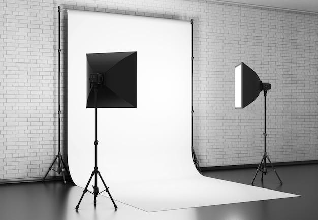 Weiß beleuchtet mit studioausrüstung gegen eine mauer. 3d-rendering.