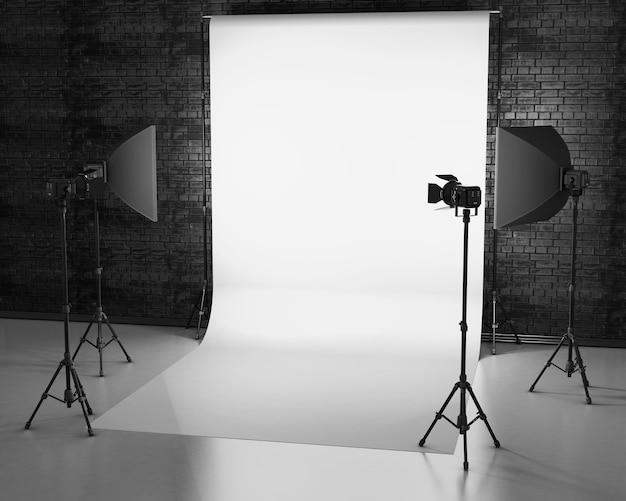 Weiß beleuchtet mit studioausrüstung gegen eine mauer. 3d.