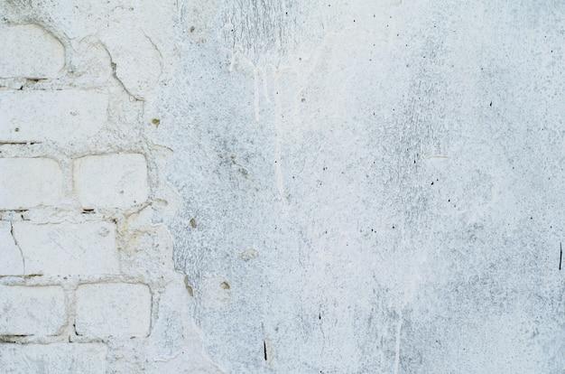 Weiß gemalte backsteinmauerbeschaffenheit für hintergrund