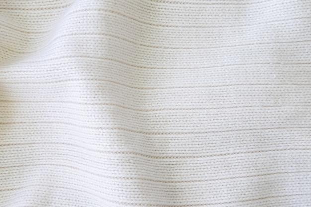 Weiß gestrickter woolen gewebebeschaffenheitshintergrund.