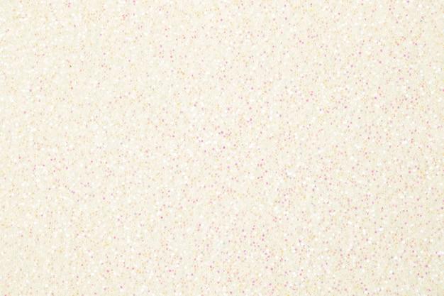 Weiß leuchtendes leuchtendes effektkonzept, glitzertexturhintergrund, sandpapper hochdetailliertes oberflächenfoto