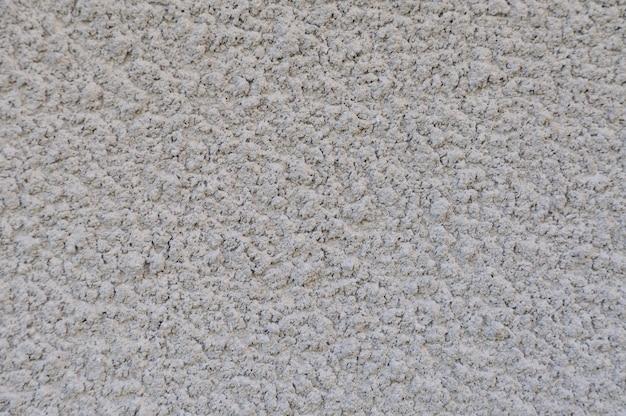 Weiß verputzter wandhintergrund oder textur