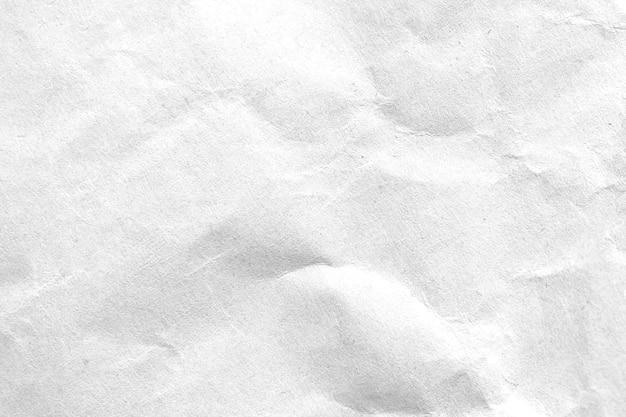 Weiß zerknitterter papierbeschaffenheitshintergrund. nahansicht.