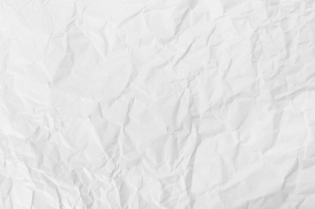 Weiß zerknitterter papierbeschaffenheitshintergrund.