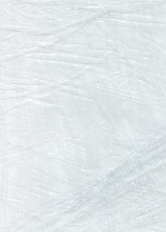 Weiß zerknittertes zellophan. polyethylen weiße textur