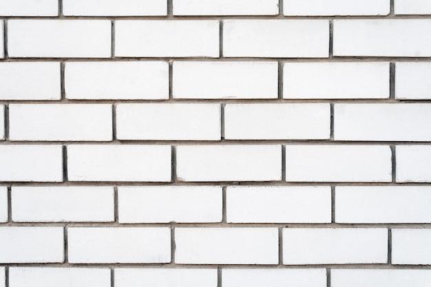 Weiße backsteinhintergrundwand mit zementmörtel