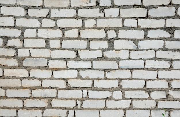 Weiße backsteinmauer, perfekt als hintergrund, quadratische fotografie
