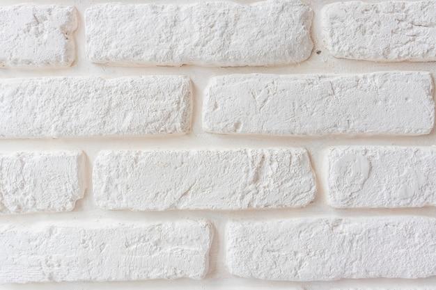 Weiße backsteinmauer, perfekt als hintergrund, quadratisches foto
