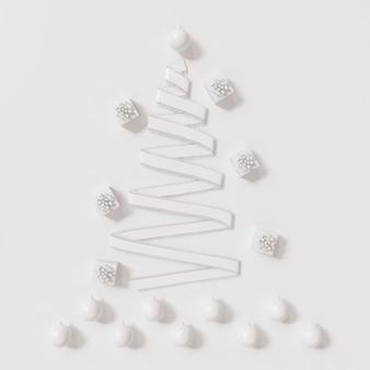 Weiße band-weihnachtstagdekorationsgegenstände formen durch weihnachtsbaum auf weiß. minimale idee. 3d-rendering.