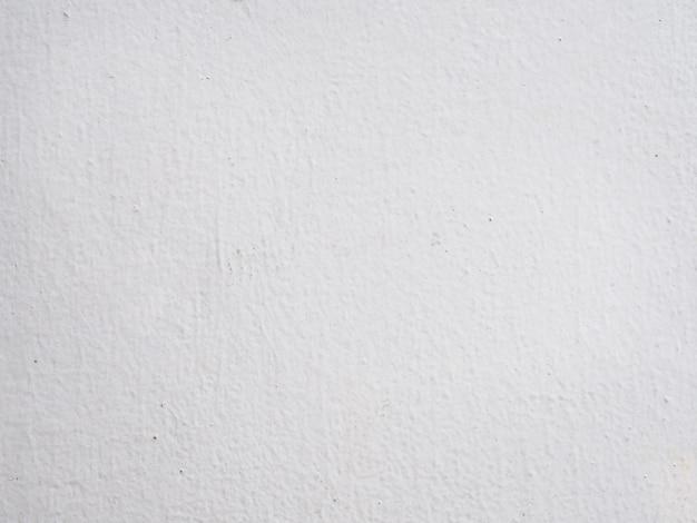 Weiße betonmauerbeschaffenheit und -hintergrund.