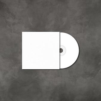 Weiße cd - dvd-etikett und cover-modellschablone isoliert auf konkretem hintergrund