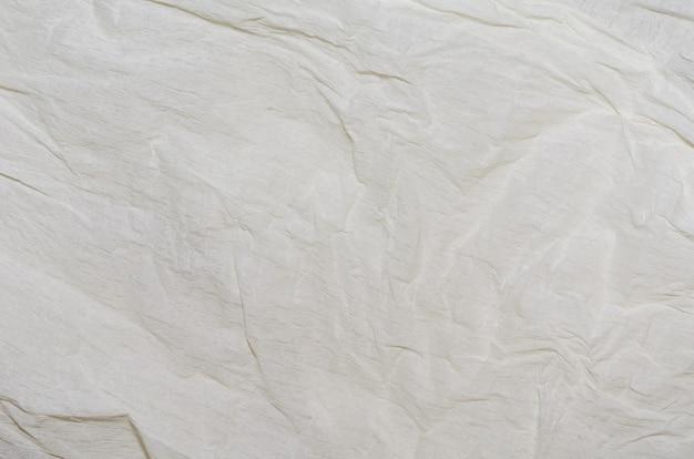 Weiße elfenbeinverpackung zerknitterter papierbeschaffenheitshintergrund