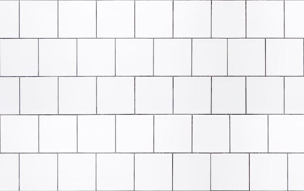 Weiße fliesenhintergrundwand mit weißen fliesen für das innere der küche oder des badezimmers