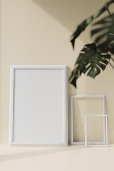 Weiße fotorahmen und grüne blätter