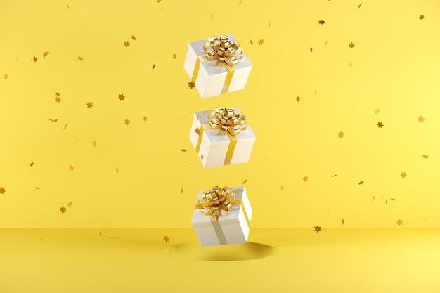 Weiße geschenkbox mit der goldenen bandfarbe, die auf gelben hintergrund schwimmt