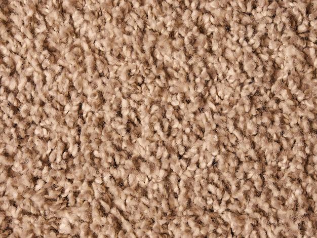 Weiße helle nahaufnahmehintergrundbeschaffenheit des teppichhaufenflorgewebes