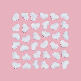 Weiße herzen in quadratischer form auf rosa fon bezeichnet. feiertagshintergrund für valentinstag. liebeskonzept.
