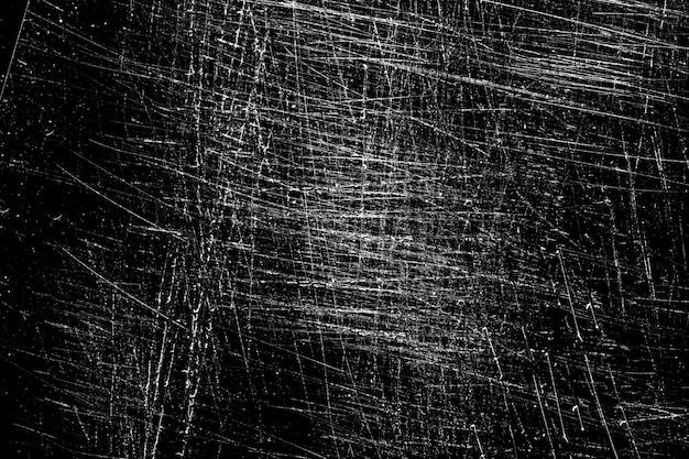 Weiße kratzer auf schwarzem hintergrund. chaotisches zerkratztes glas. foto in hoher qualität