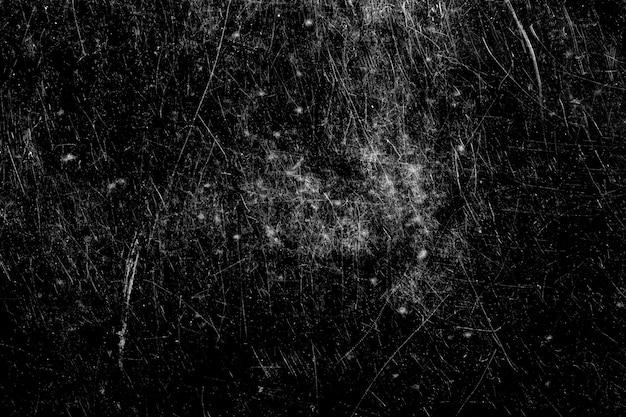 Weiße kratzer auf schwarzem hintergrund isoliert. textur für design